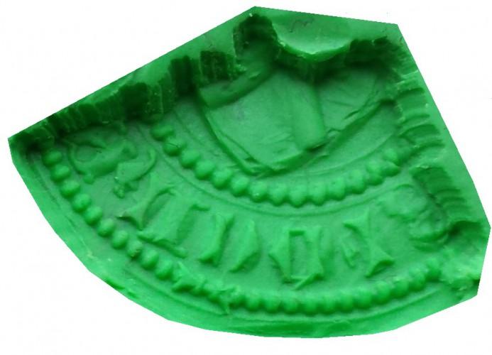 Fragment eines mittelalterlichen Siegelstempels mit gotischen Majuskeln, Süddeutschland, Abdruck