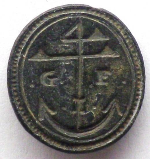 neuzeitliches Petschaft mit dem Segenszeichen 4 und Anker sowie Initialen, etwa 19.Jh., gespiegelt