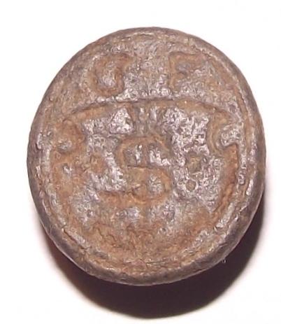 Petschaft ohne Handhabe, hausmarken-ähnliches Symbol im tartschenförmigen Wappen des 16.Jh., darüber Initialen G u. F, gespiegelt