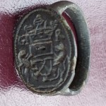 neuzeitlicher Siegelring mit Handwerks-Symbolen und Initialen, gespiegelt, um 1800