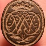 Petschaft mit Dreiloch-Handhabe und stark verschnörkelten Initialen, etwa 1700-1750