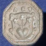 neuzeitliches Petschaft, 8-eckige Siegelfläche mit 3 Blumen aus Herz im Wappen, Initialen, 16./17.Jh, gespiegelt