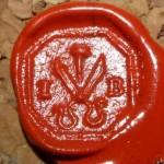 neuzeitlicher Siegelring eines Schneiders mit Schere, Nadel und Initialen, Abdruck