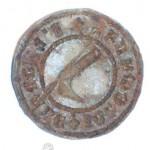 mittelalterliches Petschaft mit gothischer Umschrift, im Zentrum eine Pistole (?)