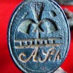 neuzeitliches Petschaft, Motiv: Symbole eines Schornsteinfegers und dessen Initialen